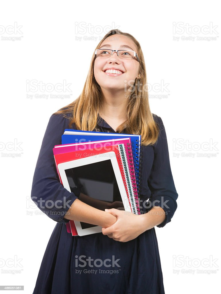 Happy female teenage student looking up smiling royalty-free stock photo