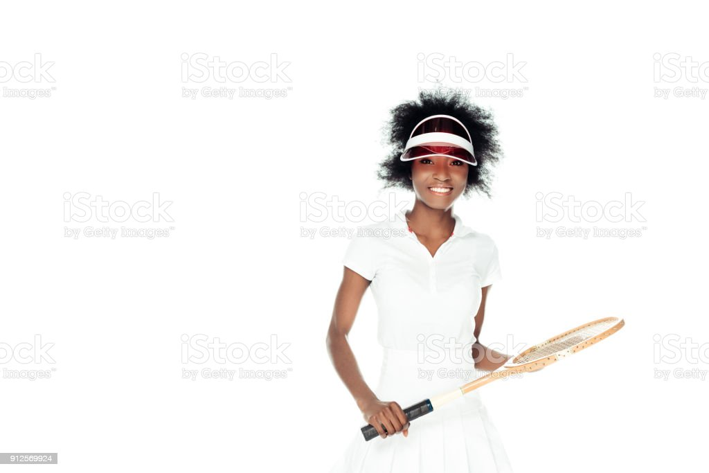 happy female tennis player in white sportswear with racket isolated on white stock photo