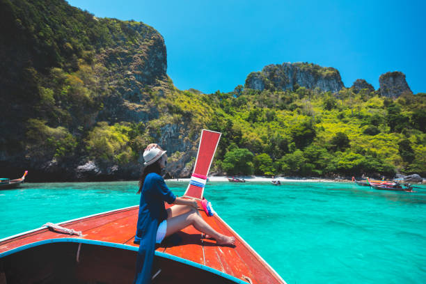 happy female traveling on boat - phuket stock photos and pictures
