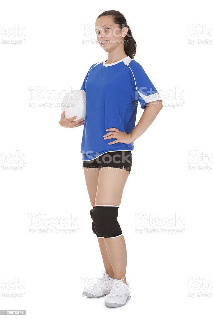 Happy female volleyball player holding ball stock photo