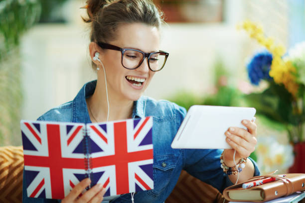 happy female with tablet PC and notebook learn stock photo