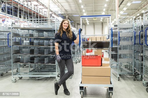 istock Happy female working working in distribution warehouse 875013888