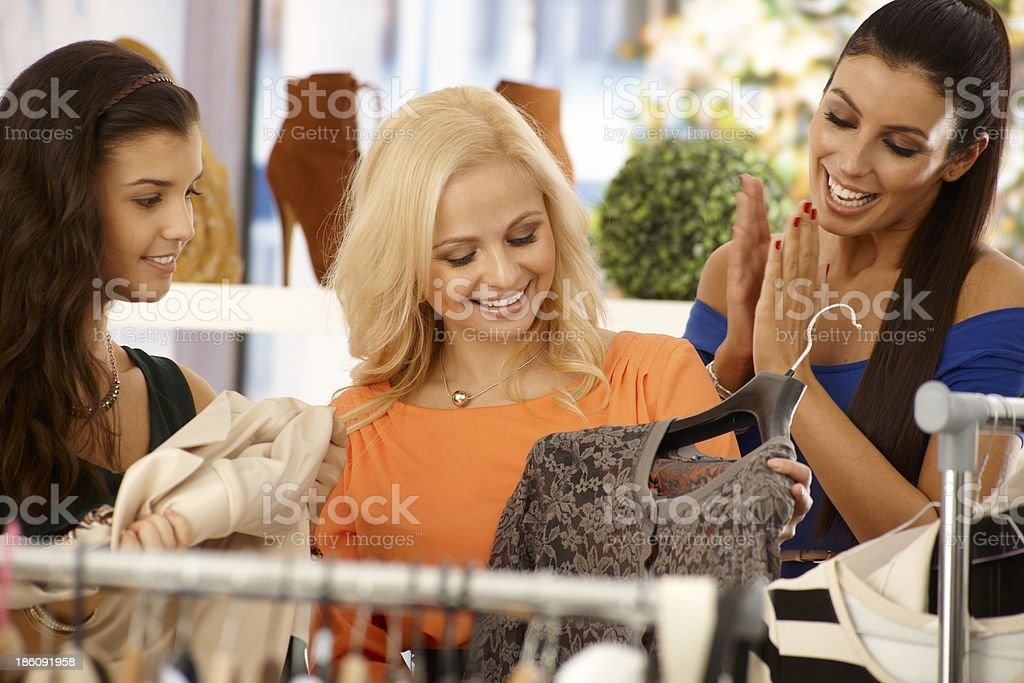 Happy females shopping at clothes store royalty-free stock photo