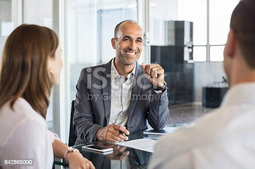 istock Happy financial agent smiling 842865000