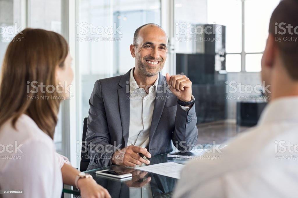 Happy financial agent smiling stock photo