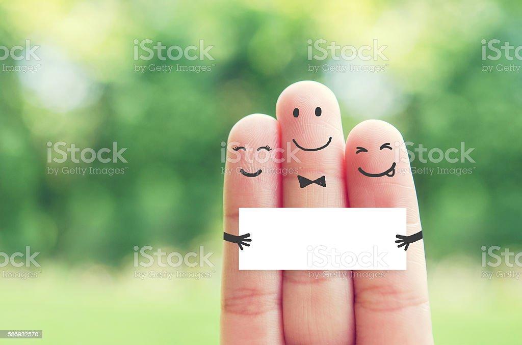 Happy finger art family group holding blank paper stock photo