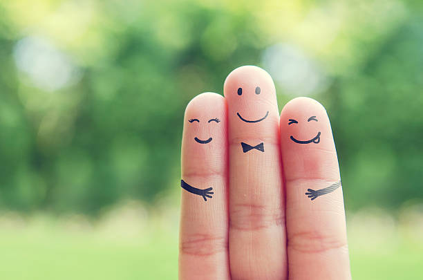 happy finger art family. - three people stock photos and pictures