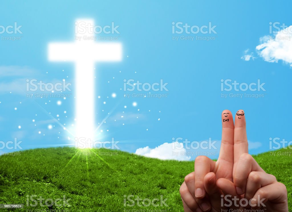 Happy finger smileys with christian religion cross stock photo