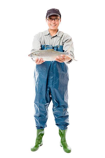 な漁師の大魚を白に隔てられた - 漁師 ストックフォトと画像