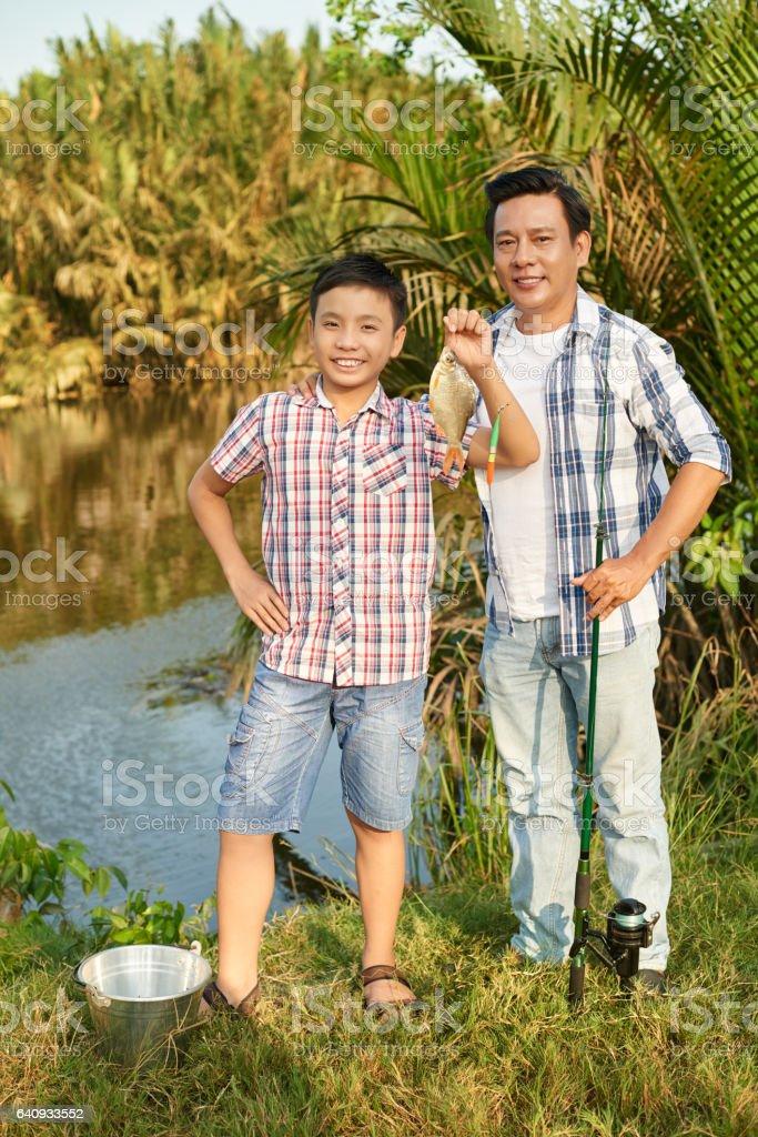 Happy fishers stock photo