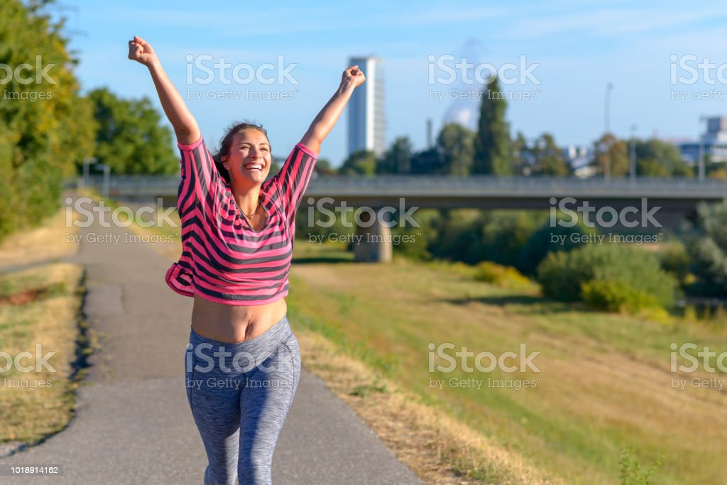 Happy fit woman cheering and celebrating royalty-free stock photo
