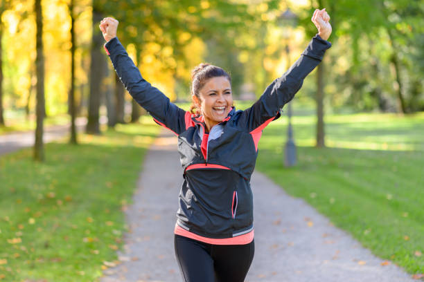 happy fit woman cheering and celebrating - relaxation exercise stock photos and pictures