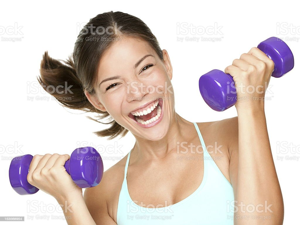 Happy fitness woman lifting dumbbells royalty-free stock photo