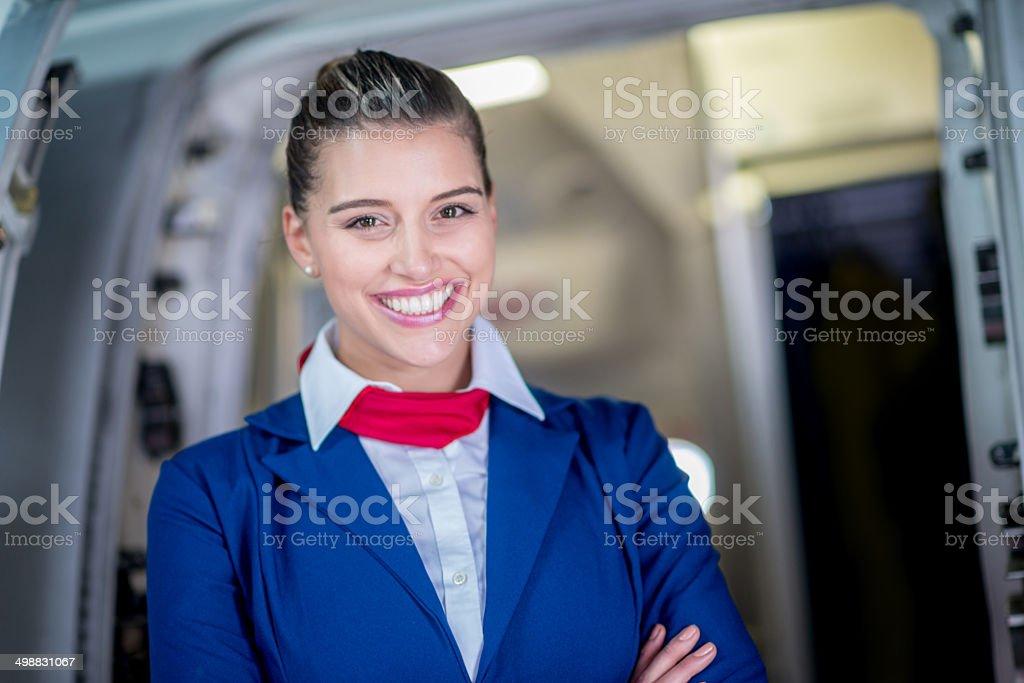 Happy flight attendant stock photo