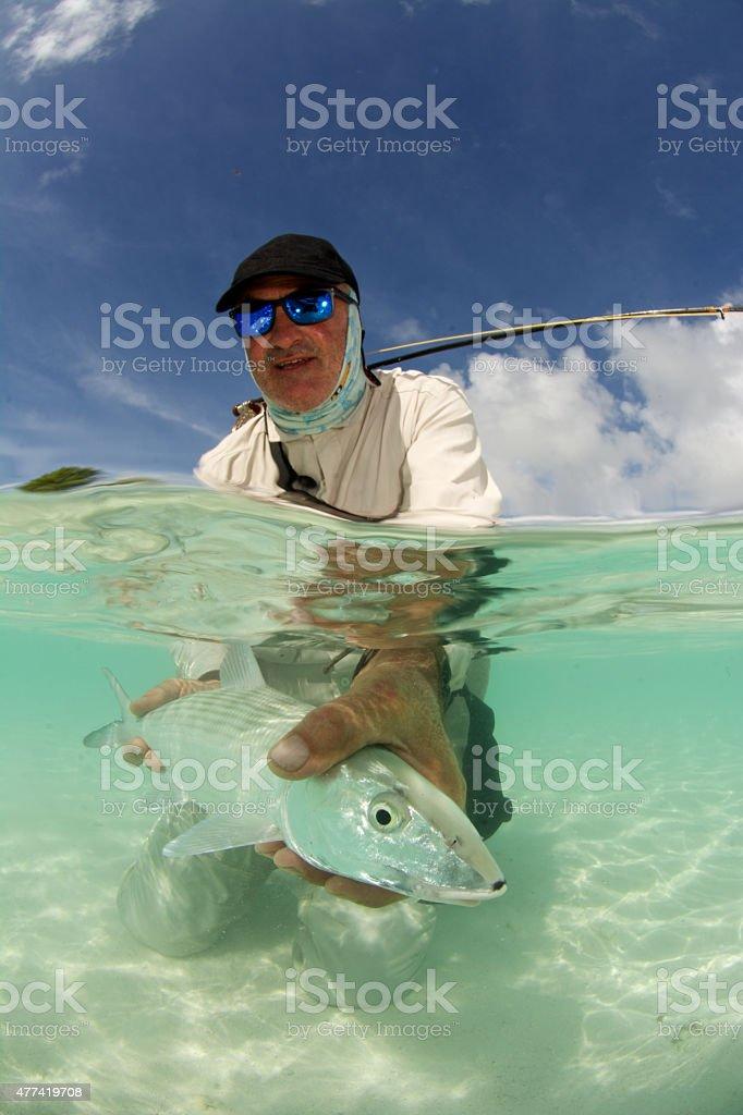 happy fly fisherman stock photo