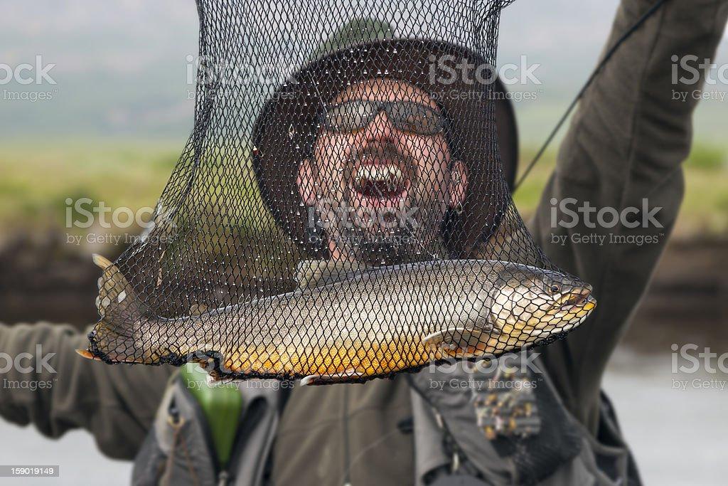 Happy flyfisherman royalty-free stock photo