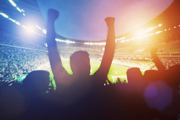 Happy football fans support their team stock photo