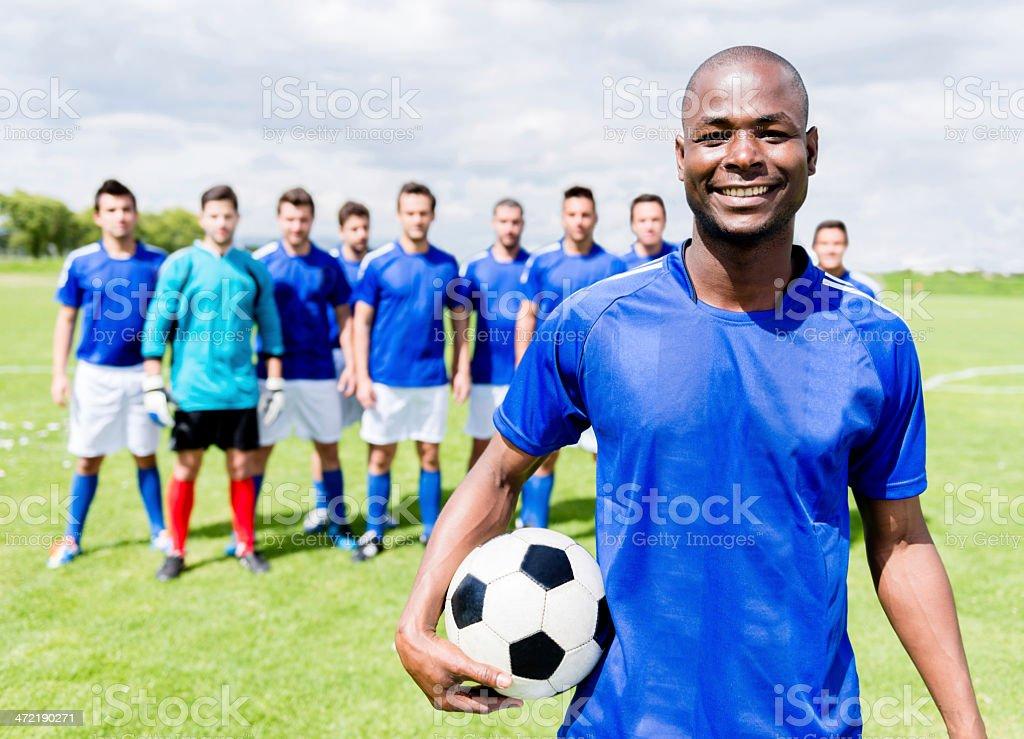 Happy football player stock photo