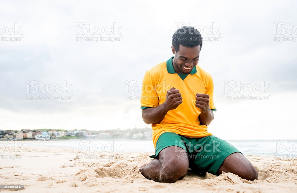 Happy football player stock photo