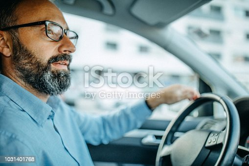 Business man driving car to work