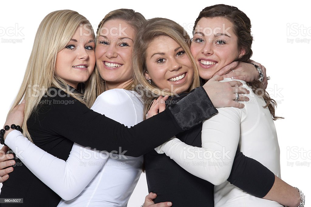Happy four women hug royalty-free stock photo
