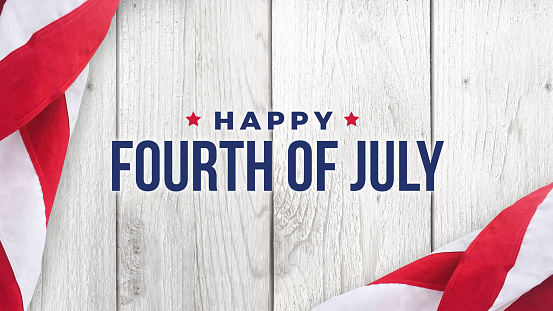 Happy Fourth Of July Text Over White Wood And American Flags Stock Photo - Download Image Now