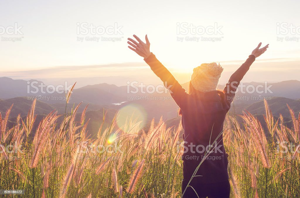 Happy Freedom in sunrise nature stock photo