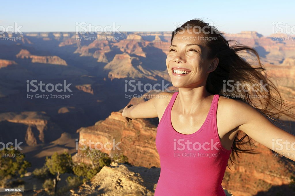 Happy freedom woman in Grand Canyon royalty-free stock photo