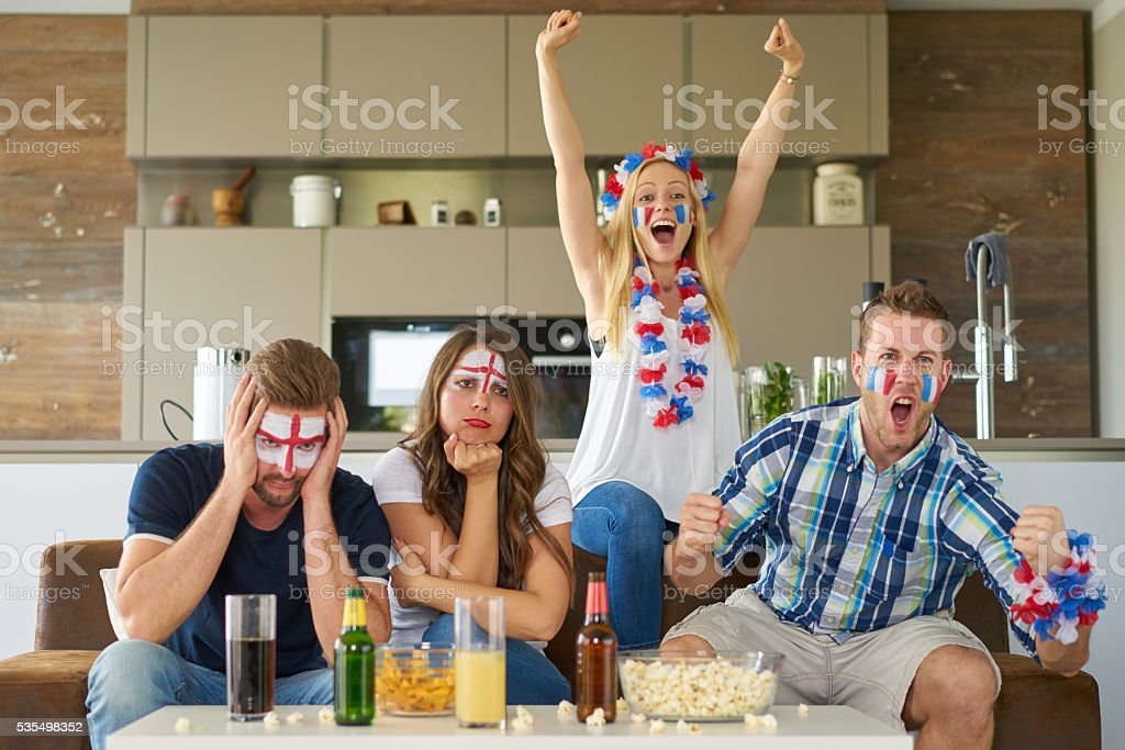 happy french and sad englsih soccer fans stock photo