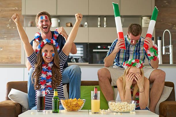 happy french and sad italian soccer fans stock photo
