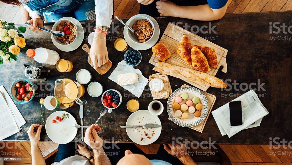 Happy french Family Having Breakfast