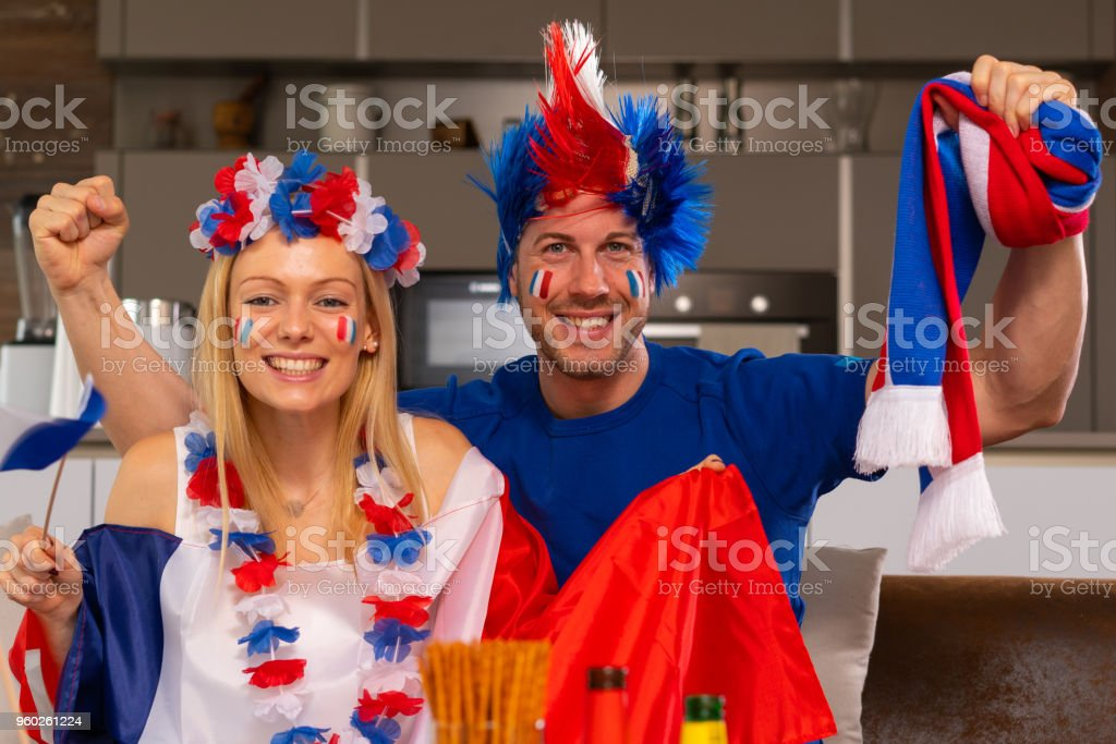 e66813b4314 Happy French Soccer Fan Couple At Home Stock Photo   More Pictures ...