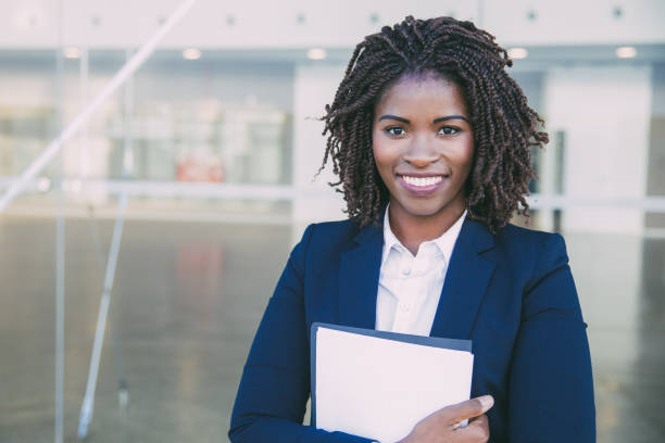 Happy friendly legal expert posing outside stock photo