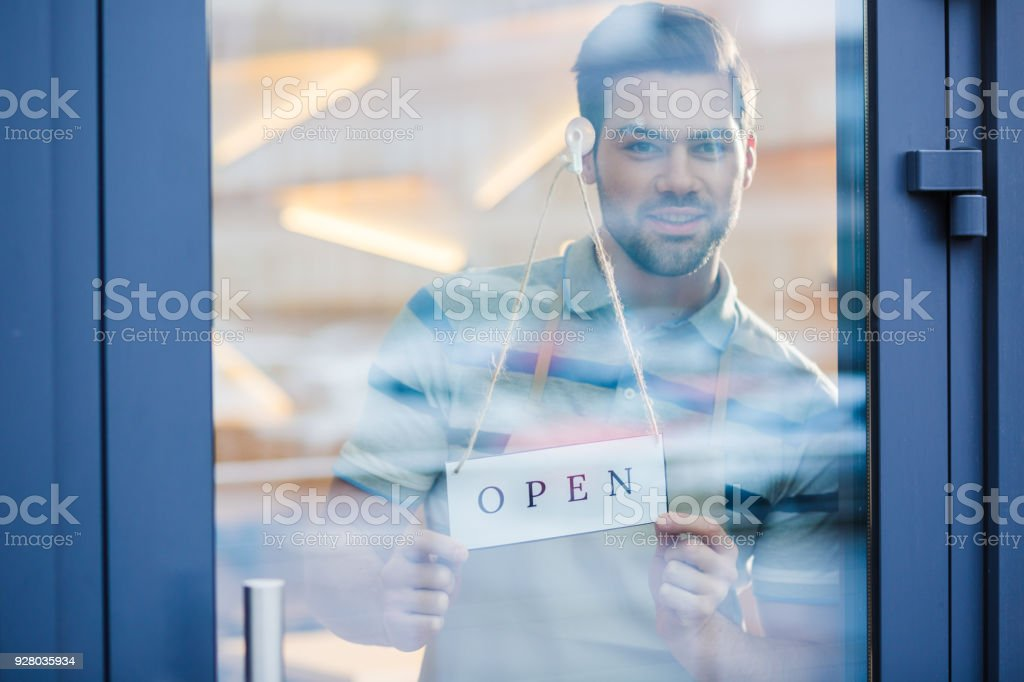 Happy Friendly Man Standing Behind The Glass Door Stock Photo More