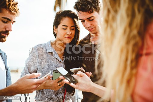 istock happy friends addicted to the social media 995909998