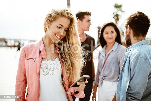 911294484istockphoto happy friends addicted to the social media 995974206