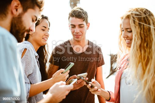 istock happy friends addicted to the social media 995974500