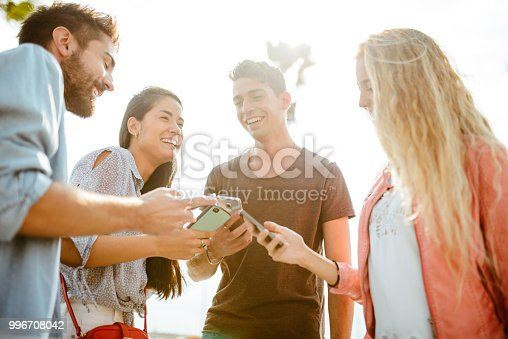 istock happy friends addicted to the social media 996708042