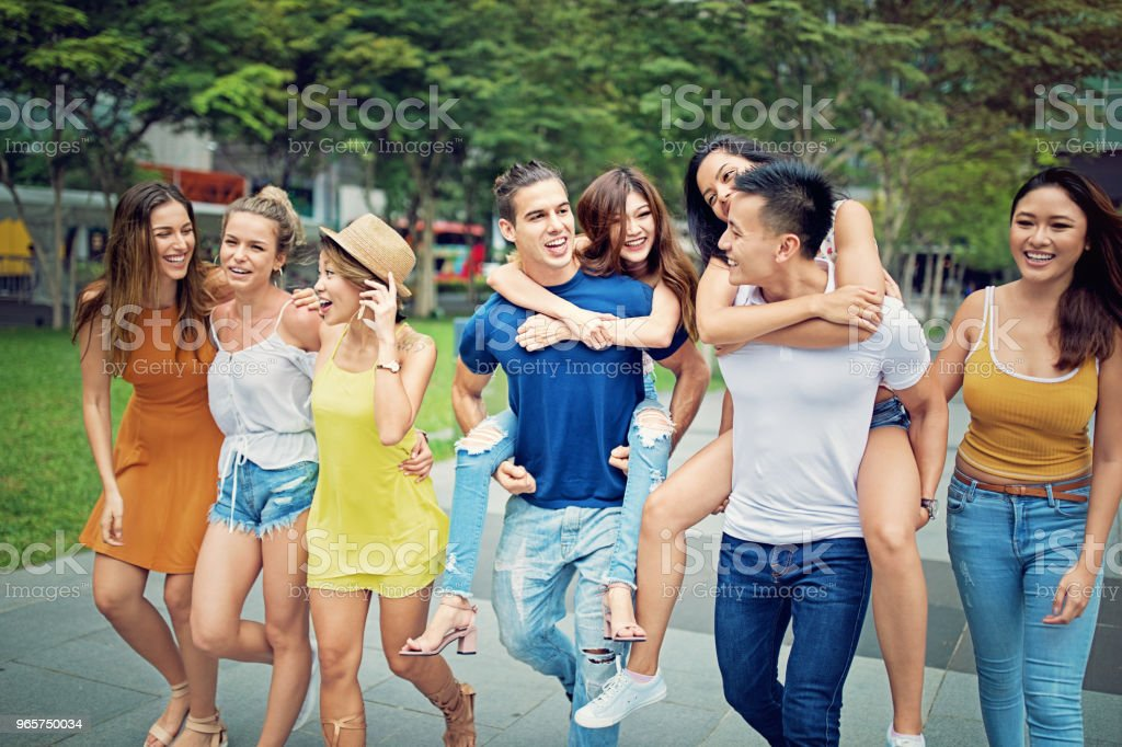 Happy friends are hugging and walking together - Royalty-free Adult Stock Photo