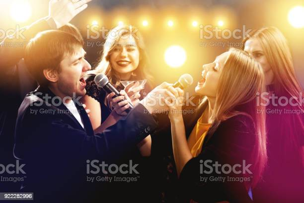 Happy friends are singing and dancing in night club picture id922282996?b=1&k=6&m=922282996&s=612x612&h=k5lhphnofd0g93 0jns9znzmdndbltq8dirpa9ya4gs=