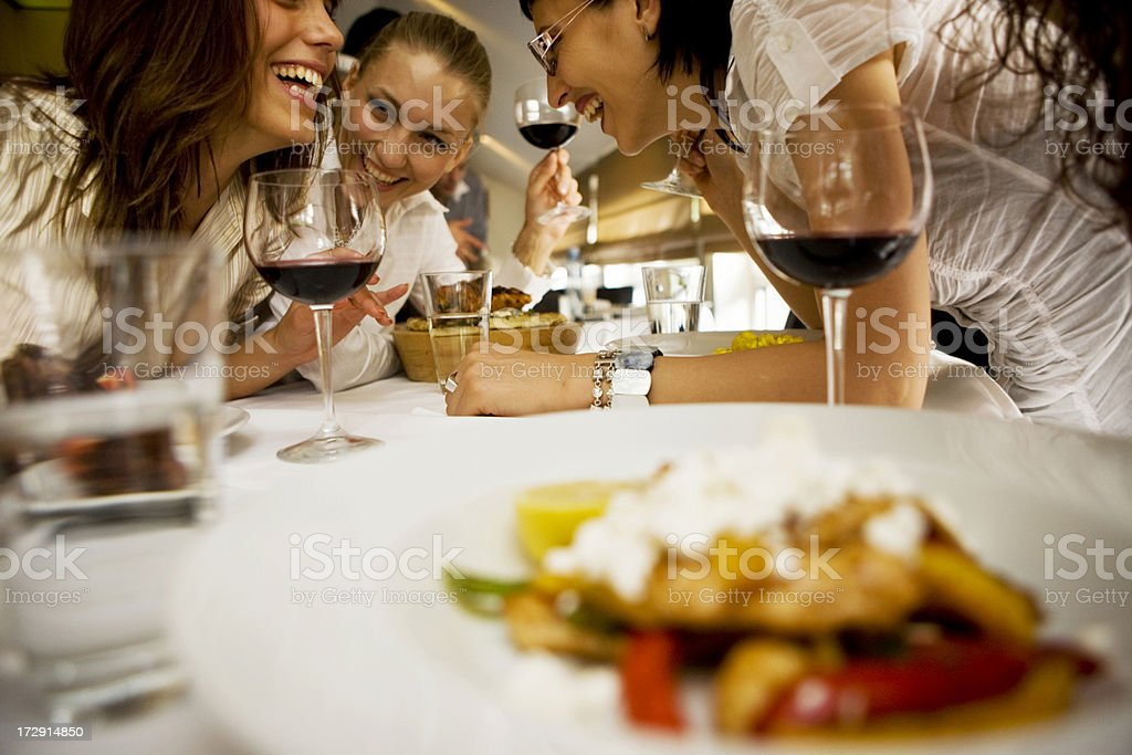 Happy friends at dinning table stock photo