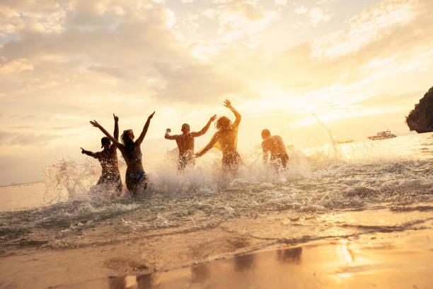 Happy friends at idyllic sea sunset