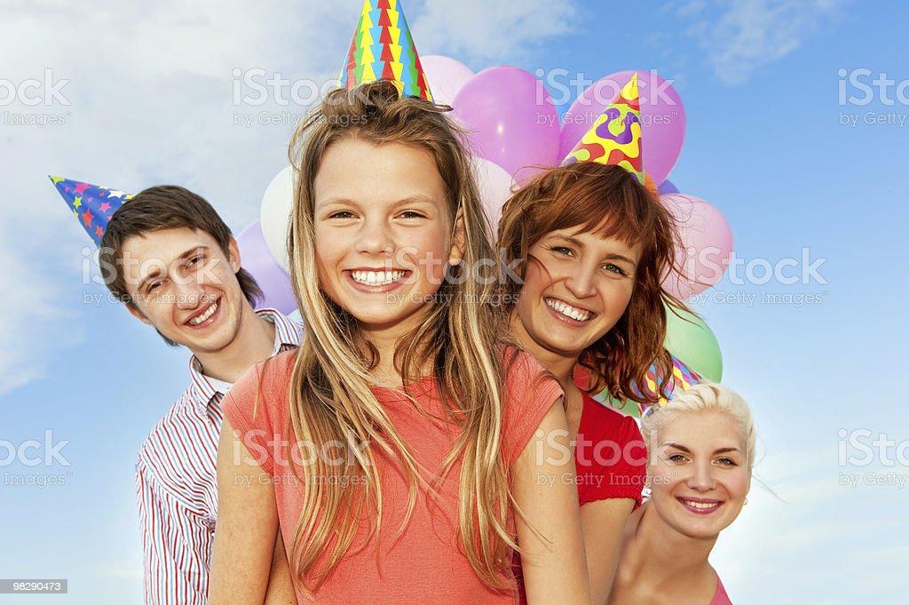 Happy friends celebrating royalty-free stock photo