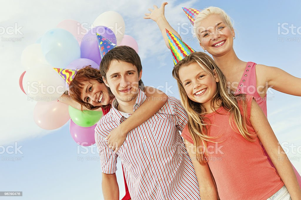 Happy friends celebrating royalty-free stock photo