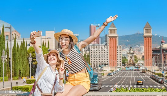 Happy friends doing selfie at the viewpoint at Espanya Square in Barcelona. Summer vacation Europe travel