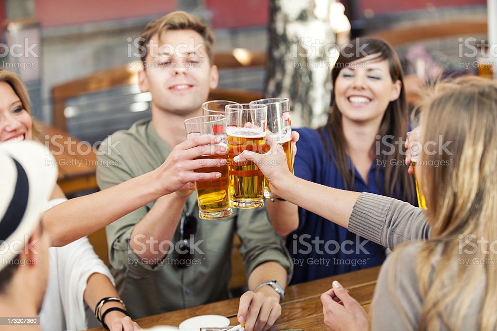 Happy Friends Drinking Beer royalty-free stock photo