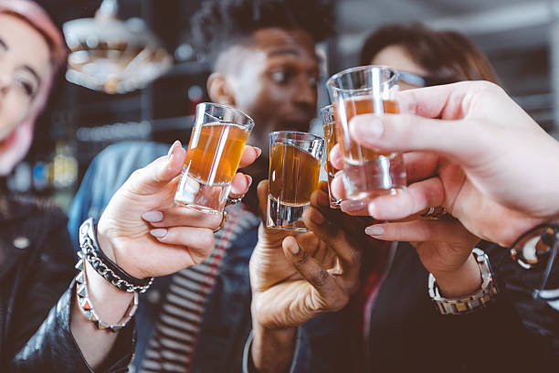 Happy friends drinking shots - Photo