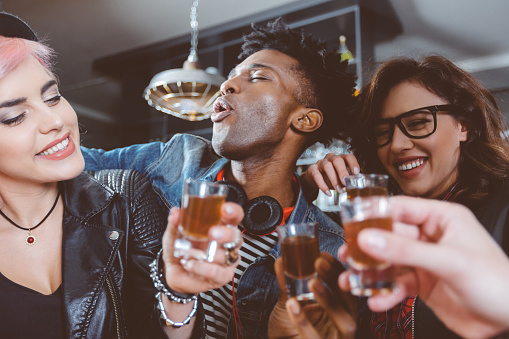 Happy Friends Drinking Shots Stock Photo - Download Image Now