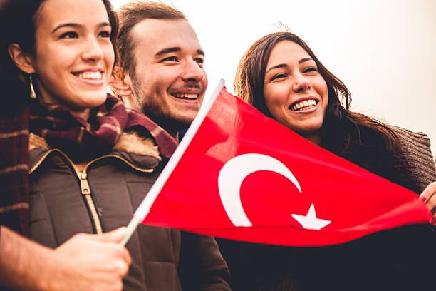 happy friends during a demonstration - turkse etniciteit stockfoto's en -beelden