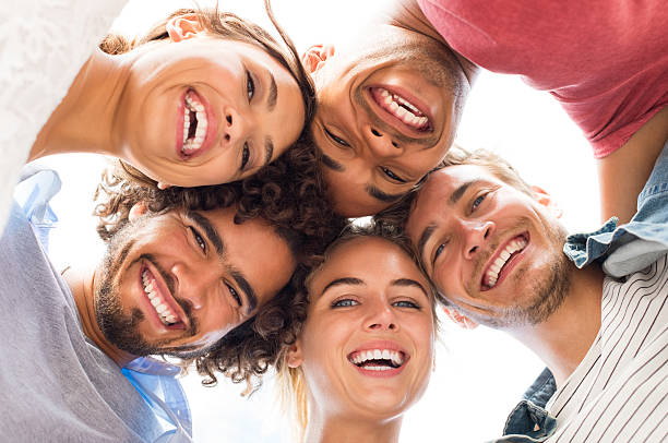 Happy friends embracing stock photo